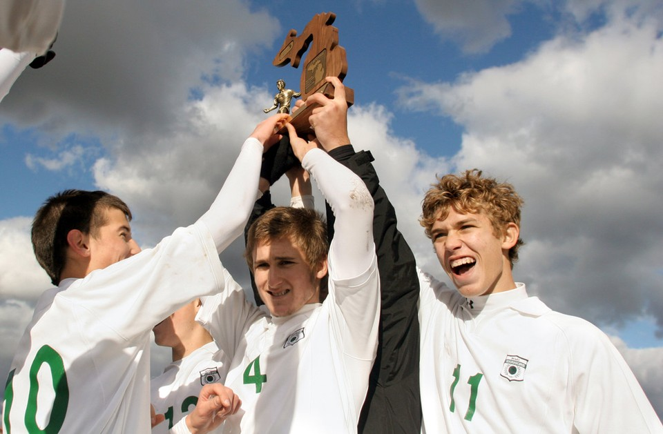 WMC Hoisting Soccer Trophy